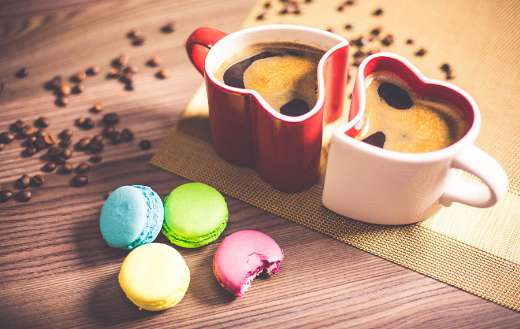 Black coffee with colorful macaroons