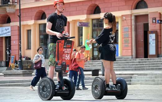 Electric vehicles young tourists people
