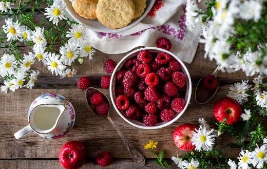 Summer raspberries ripe harvest in bowl