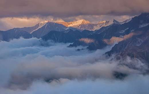 The Caucasus Russia mountain fog sunset clouds
