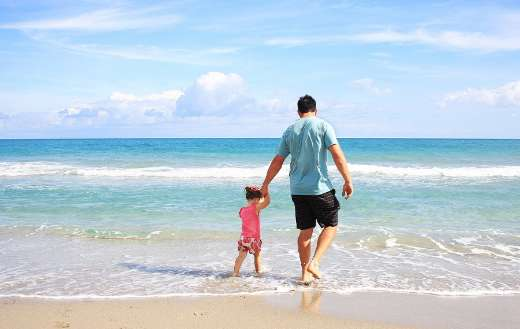 Father daughter family beach vacation