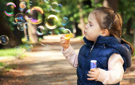 Soap bubbles child joy play