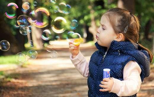 Soap bubbles child joy play