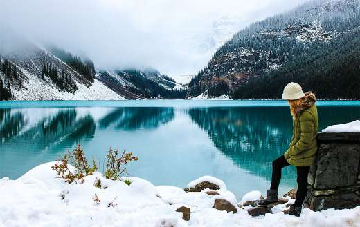 Adventure female hiker in a beatiful lake