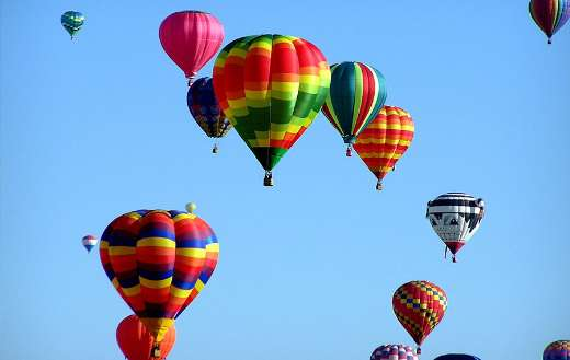 Red green hot air balloon during daytime puzzle
