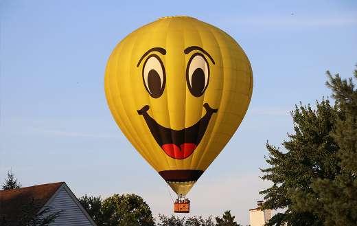 Yellow hot air balloons on air