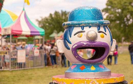 Clown face amusement ride