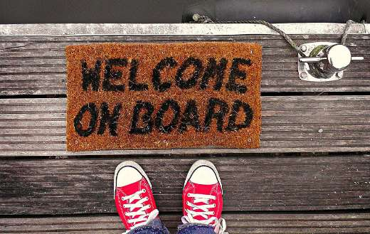 Dock with welcome on board doormat