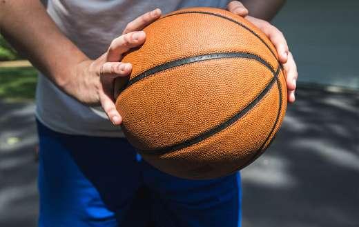 Man holding a ball online