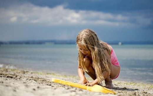 Beach kid sand play childhood