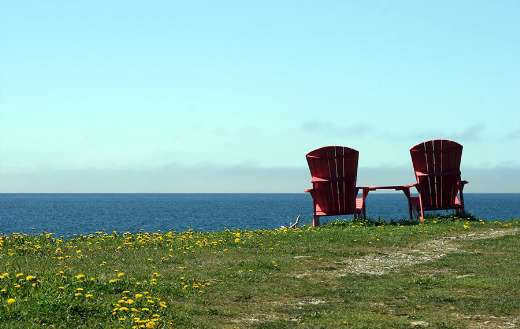Ocean view with two red chair