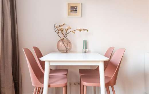 Dining able and pink chairs in light dining room