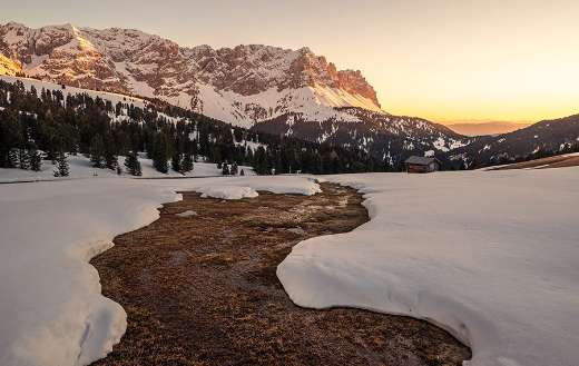 Lake almost covered by snow