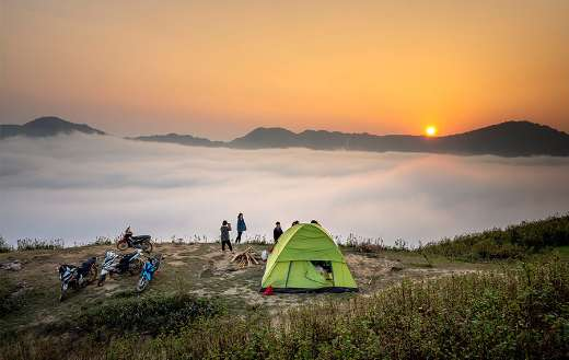 Camping tent overlooking sea of clouds