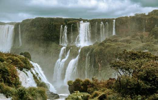 Water falls under cloudy sky online