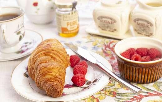 Breakfast croissant bread and raspberry